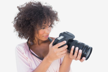 Smiling woman looking at digital camera