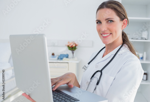 Woman doctor using laptop
