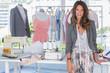 Fashion designer standing in a bright creative office