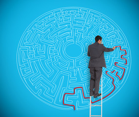Businessman drawing red line to solve a complex maze