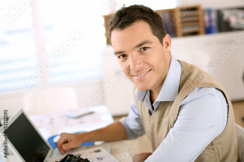 Portrait of smiling man sitting in office