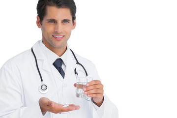 Happy doctor holding tablets and water