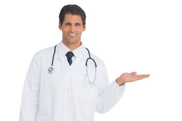 Happy doctor showing something and smiling