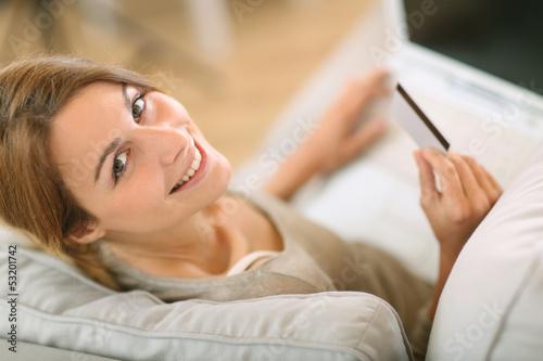 Upper view of woman in sofa shopping on internet
