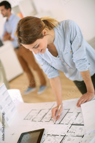 Young woman architect working in office