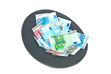 Hat with euro banknotes