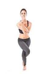 woman making a Yoga pose: Eagle Pose – Garurasana