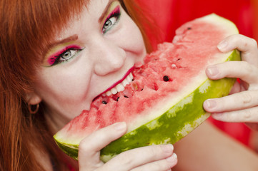 bright girl enjoying sweet watermelon