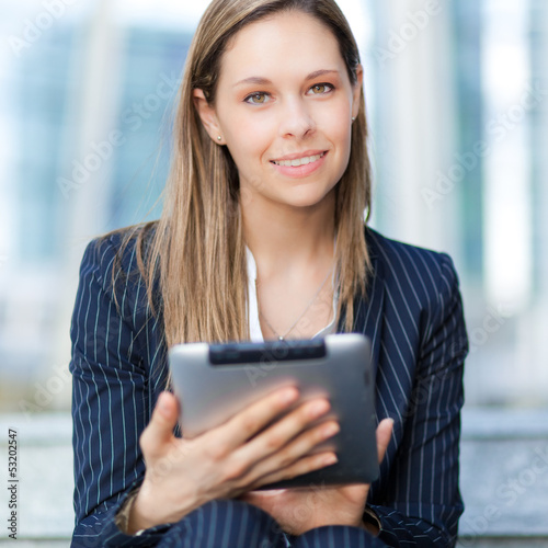 Beautiful businesswoman using a digital tablet