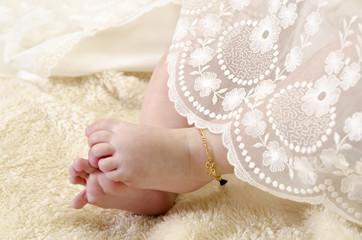 Baby feet with ceremonial clothes
