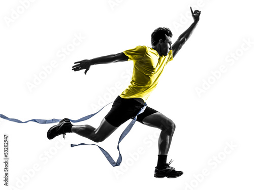 young man sprinter runner running winner finish line silhouette