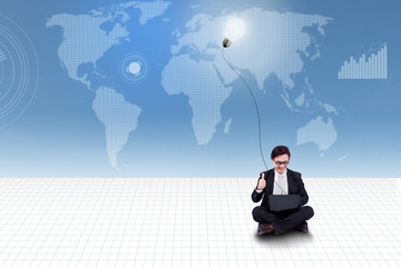Businessman give thumb up on world map background