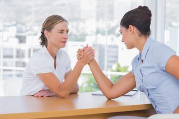 Businesswomen having an arm wrestle
