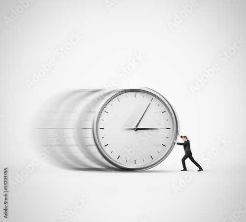 businessman pushing clock