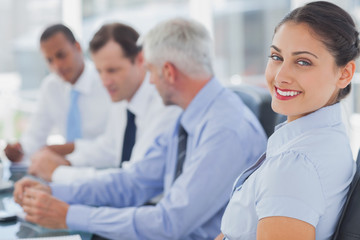 Attractive businesswoman posing in the meeting room