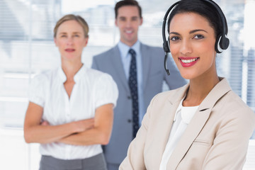Attractive woman with headset crossing her arms