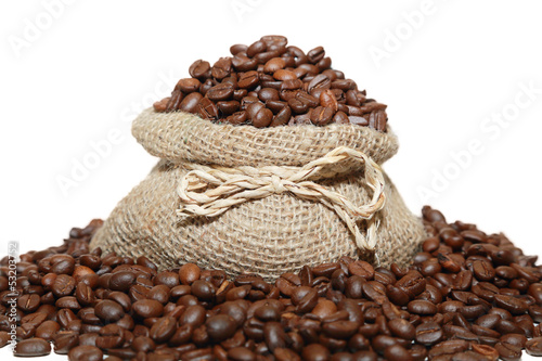 isolated coffee beans in a burlap bag