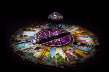 Tarot card reading with crystal ball.