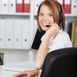 Rear view of female call center employee