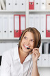 Laughing businesswoman talking on headset