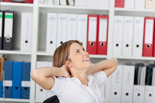 Happy woman relaxing in the office