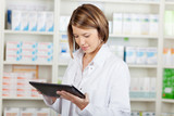 Pharmacist working with a tablet-pc