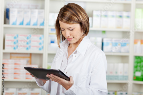 Pharmacist working with a tablet-pc - 53205304