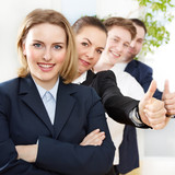Successful business people are in line, show thumbs up