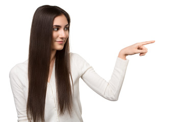 Portrait of attractive businesswoman pointing her finger