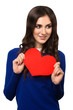 Young woman holding Valentines Day heart sign with copy space