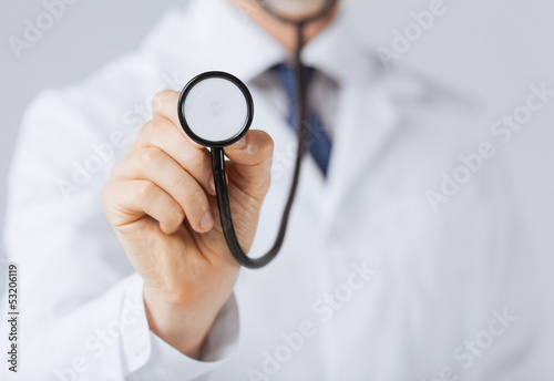 doctor hand with stethoscope listening something