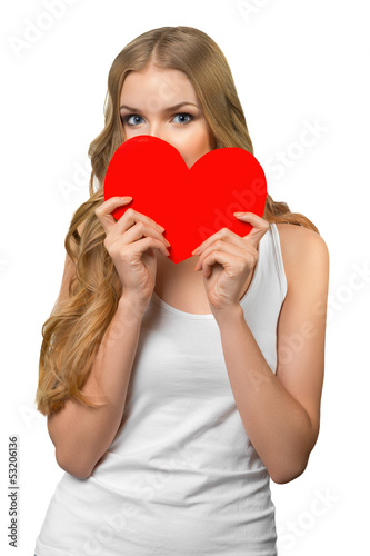Young beautiful female peeking from the heart shape