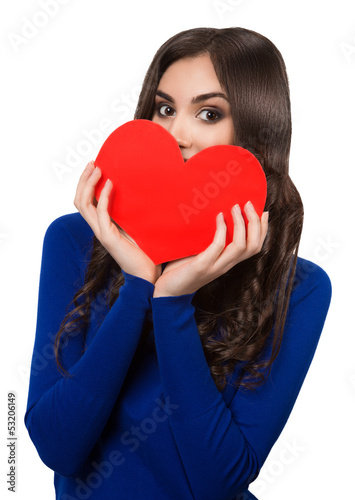 Young beautiful women peeking from the heart shape