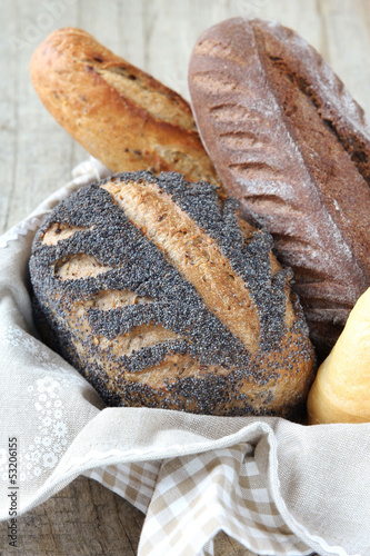 Assortment of delicious fresh French bread in a basket