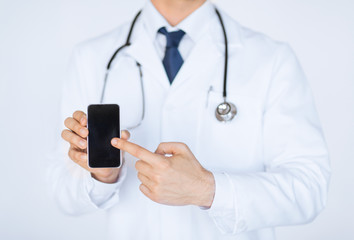 doctor pointing at smartphone