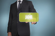 Businessman touching green tag with the word job written on it