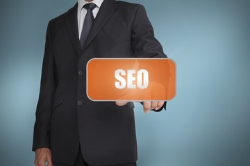 Businessman selecting orange tag with the word seo written on it