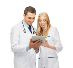 young doctors working with tablet pc
