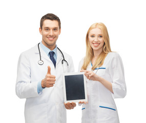 young doctors holding tablet pc in hands