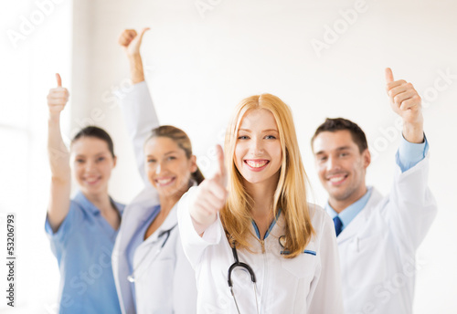 group of doctors showing thumbs up