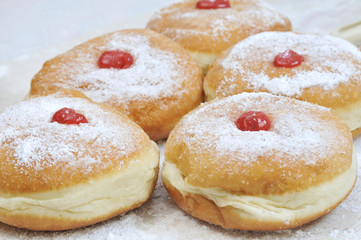 Hanukkah sufganiya, doughnut with jam and caster suga