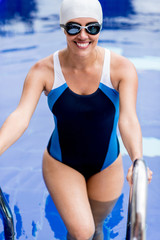 Woman coming out of the swimming pool