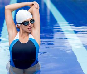 Female swimmer stretching