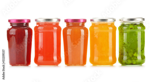 Jars of fruity jams isolated on white background
