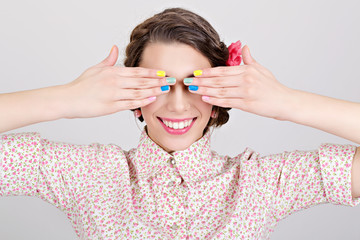 Happy young pin-up girl with colorful nails