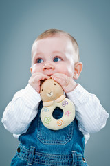 Cute Baby Eating a Toy