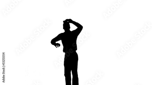 Silhouette of a jumping man turning on white background