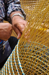 man making a wicker basket