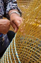 man making a wicker basket