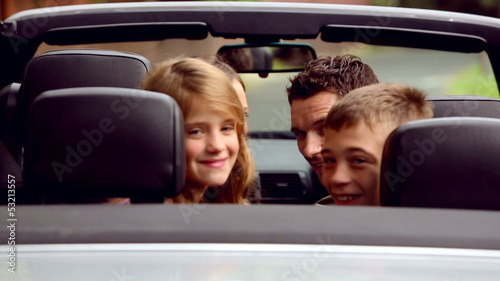 Family in a silver car